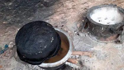 Woman boiling stones to make her children believed they will eat