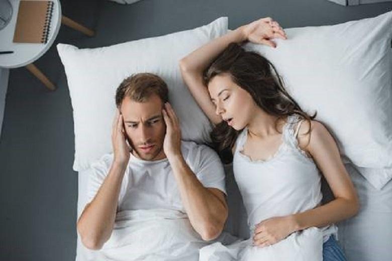 What external factors cause snoring?