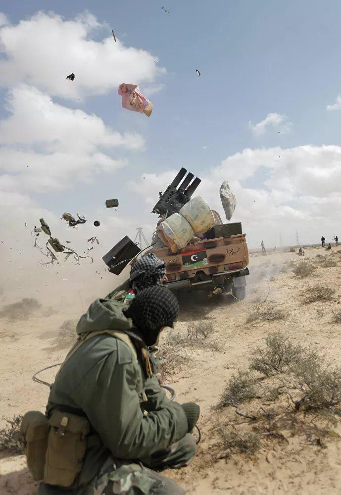 ©AP/NASSER NASSER - Libyan leader Muammar Gaddafi was overthrown on August 23, 2011, and killed on October 20, 2011, in his hometown of Sirte. Pictured: Libyan rebel firing at government forces near the town of Marsa El Brega in eastern Libya on March 31, 2011.