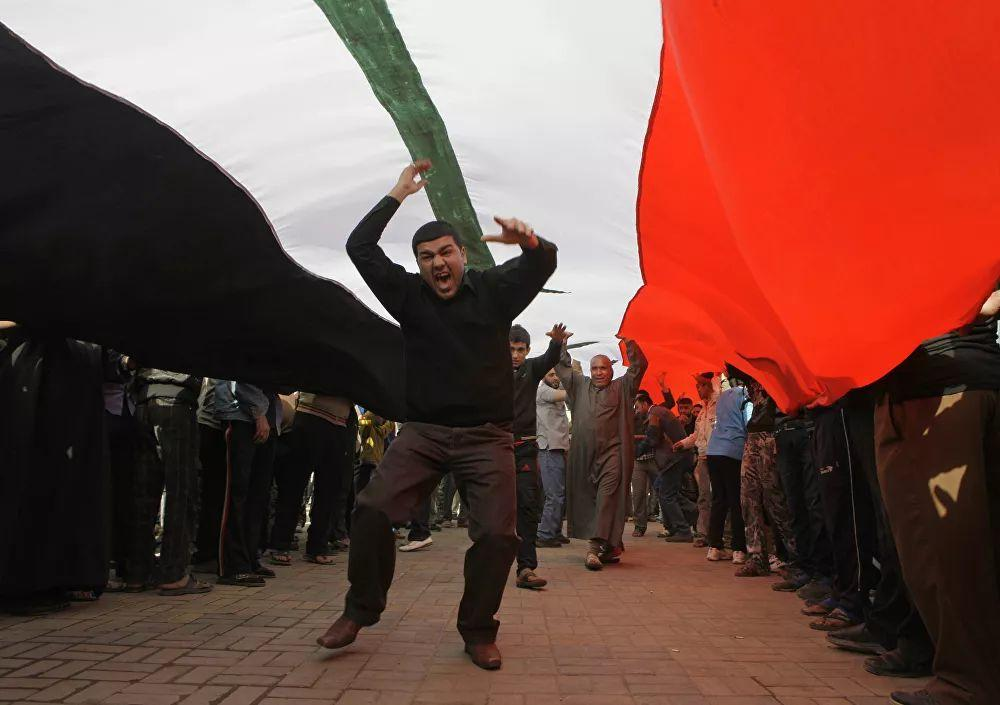 Following democratic elections, radical Islamic movements have come to power in some countries, for example, in Tunisia. The economic damage to the region is between 225 and 600 billion dollars. Pictured: Participants in an anti-government rally in Tahrir Square in Baghdad, February 23, 2011.