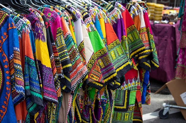 A rack of colorful dashikis