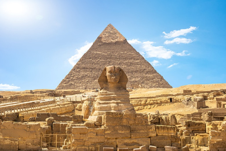 Front view of Sphinx and Khafre pyramid in the desert of Giza, Egypt