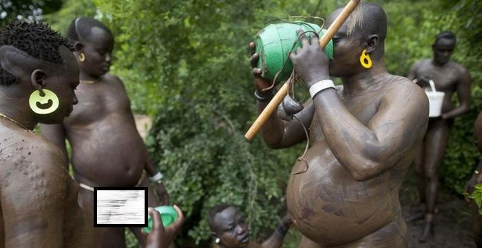 Bodi tribal men drinking blood with milk