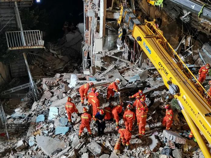 The rescue  team at the collapsed Hotel in China